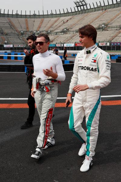 Tom Kristensen (DNK) and Esteban Gutierrez (MEX) walk the track