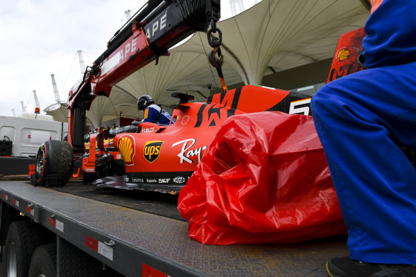 Damaged car of Sebastian Vettel, Ferrari SF90 being returned to the Ferrari garage on the back of a low loader