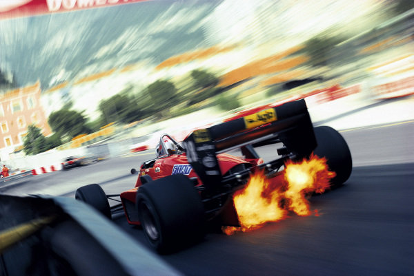 Exhaust flames shoot up through the diffuser of Stefan Johansson's Ferrari 156/85 as he exits Rascasse corner.
