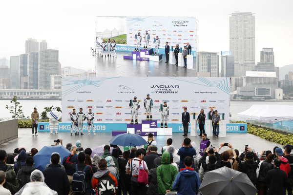 The PRO AM podium ceremony: winner Yaqi Zhang (CHI), Team China, Bandar Alesayi (SAU), Saudi Racing, 2nd position, and Célia Martin (FRE), Viessman Jaguar eTROPHY Team Germany, 3rd position