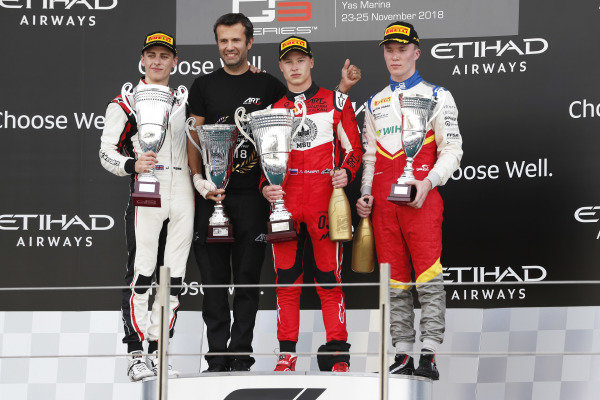 Jake Hughes (GBR, ART Grand Prix), Nikita Mazepin (RUS, ART Grand Prix), and Simo Laaksonen (FIN, Campos Racing), celebrate on the podium.