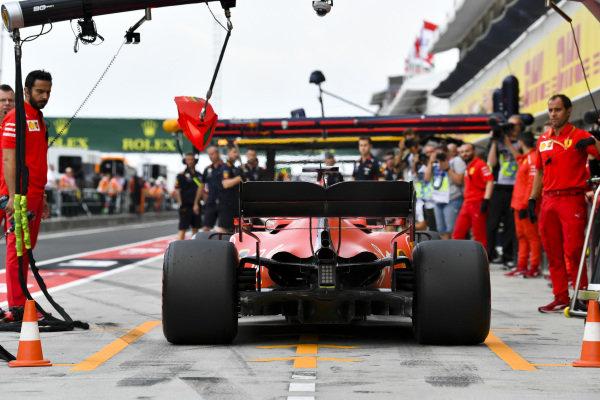 Sebastian Vettel, Ferrari SF90, in the pits during practice