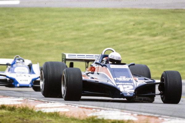 Elio de Angelis, Lotus 81 Ford, leads Jacques Laffite, Ligier JS11/15 Ford.