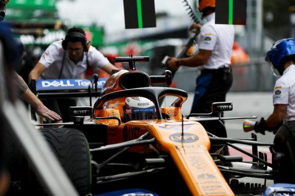 Carlos Sainz Jr., McLaren MCL34, makes a pit stop during practice