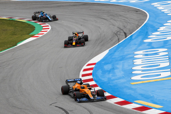 Daniel Ricciardo, McLaren MCL35M, leads Sergio Perez, Red Bull Racing RB16B, and Esteban Ocon, Alpine A521