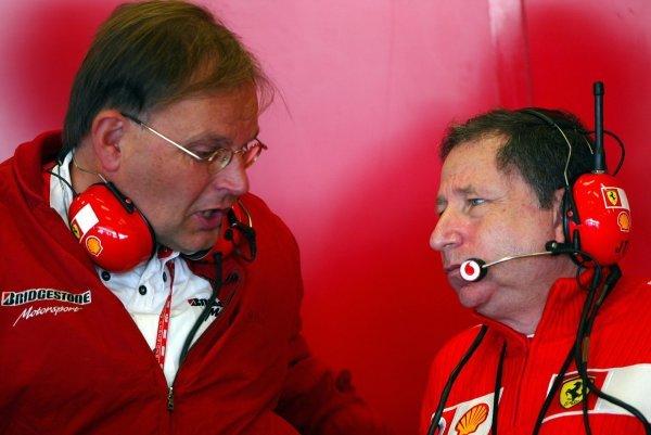 (L to R): Kees van de Grint (NED) Senior Bridgestone Engineer talks with Jean Todt (FRA) Ferrari General Manager. Formula One World Championship, Rd15, United States Grand Prix, Indianapolis, USA, 27 September 2003. DIGITAL IMAGE