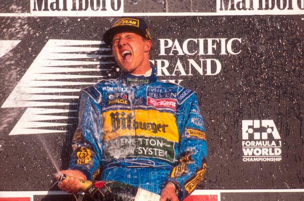 Tanaka International, Aida, Japan.20-22 October 1995.Michael Schumacher (Benetton Renault) 1st position, celebrates taking his second successive drivers world championship on the podium.Ref-95 PAC 05.World Copyright - LAT Photographic