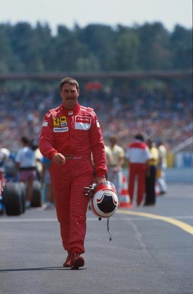 Nigel Mansell walks back to the pits after retiring German GP, Hockenheim, Germany, 29 July 1990