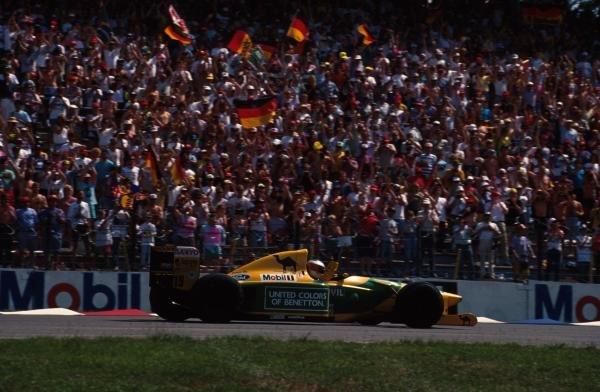 Michael Schumacher (GER) Benetton B192, waves to the German crowds after his first home Grand Prix. German Grand Prix, Hockenheim, 26 July 1992