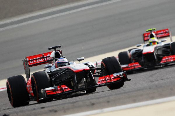 Bahrain International Circuit, Sakhir, Bahrain Sunday 21st April 2013 Jenson Button, McLaren MP4-28 Mercedes, leads Sergio Perez, McLaren MP4-28 Mercedes.  World Copyright: Andy Hone/LAT Photographic ref: Digital Image HONY1325