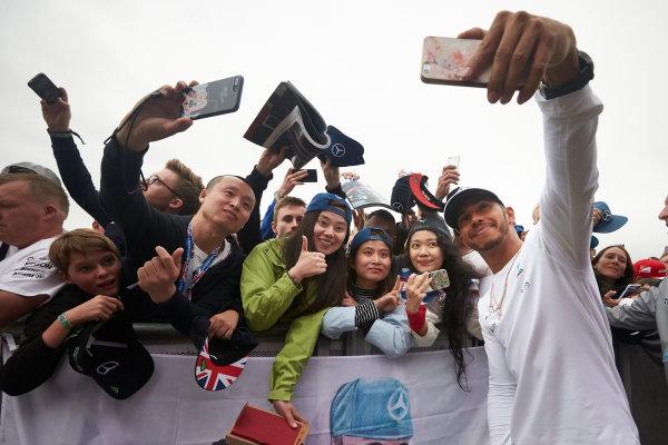 Silverstone, Northamptonshire, UK.  Saturday 15 July 2017. Lewis Hamilton, Mercedes AMG, takes a photo with fans. World Copyright: Steve Etherington/LAT Images  ref: Digital Image SNE18271