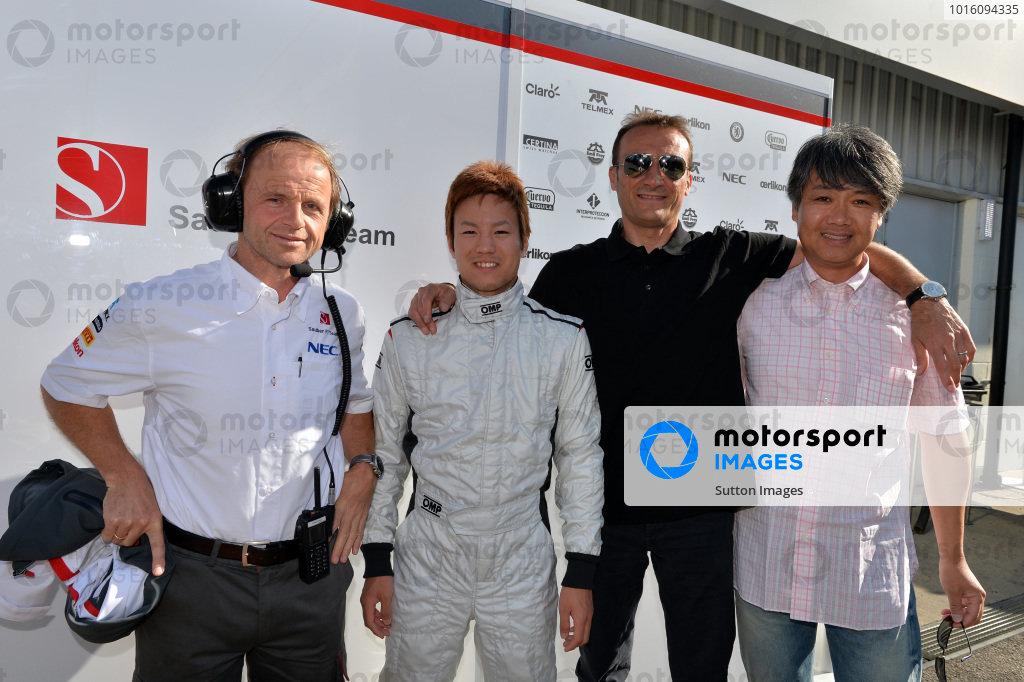 (L to R): Josef Leberer (SUI) Sauber Physio, Kimiya Sato (JPN) Sauber, Vincenzo Sospiri (ITA) and Taki Inoue (JPN). Formula One Young Drivers Test, Silverstone, England, Day Three, Friday 19 July 2013.  BEST IMAGE