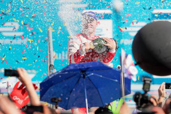 2016/2017 FIA Formula E Championship. Round 7 - Berlin ePrix, Tempelhof Airport, Berlin, Germany. Saturday 10 June 2017. Felix Rosenqvist (SWE), Mahindra Racing, Spark-Mahindra, Mahindra M3ELECTRO sprays the champagne on the podium. Photo: Zak Mauger/LAT/Formula E ref: Digital Image _54I7713
