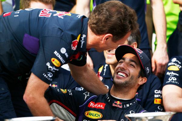 Hungaroring, Budapest, Hungary. Sunday 27 July 2014. Daniel Ricciardo, Red Bull Racing, 1st Position, and Christian Horner, Team Principal, Red Bull Racing, celebrate with their team. World Copyright: Sam Bloxham/LAT Photographic. ref: Digital Image _SBL1295