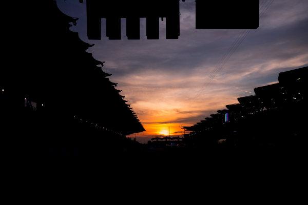 Sepang International Circuit, Sepang, Malaysia. Friday 29 September 2017. Sun rises at the Sepang Circuit. World Copyright: Zak Mauger/LAT Images  ref: Digital Image _56I2074