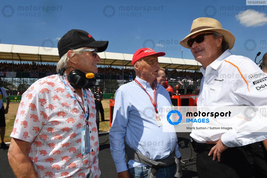 Mansour Ojjeh (KSA) McLaren, Niki Lauda (AUT) Mercedes AMG F1 Non-Executive Chairman and Michael Douglas (USA) on the grid
