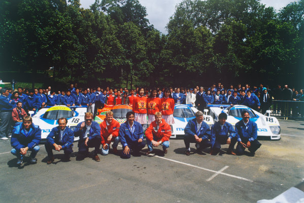 Le Mans, France. 22 - 23 June 1991. All 3 Mazda cars with drivers and team personnel at scrutineering, portrait.  World Copyright: LAT Photographic. Ref: 91LM05.