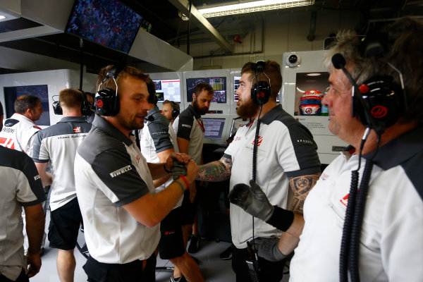 Suzuka Circuit, Japan. Saturday 8 October 2016. Haas F1 engineers celebrate a successful qualifying session. World Copyright: Andrew Hone/LAT Photographic ref: Digital Image _ONZ4667