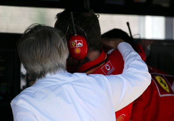 (L to R): Bernie Ecclestone (GBR) F1 Supremo has a quiet word in the ear of Jean Todt (FRA) Ferrari General Manager.Formula One World Championship, Rd13, Hungarian Grand Prix, Hungaroring, Hungary, 23 August 2003.DIGITAL IMAGE