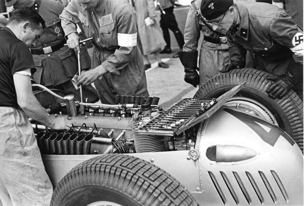 Nurburgring, Germany.25 July 1937.The engine in Bernd Rosemeyer's Auto Union C-typ is inspected by a party member.World Copyright - LAT Photographic