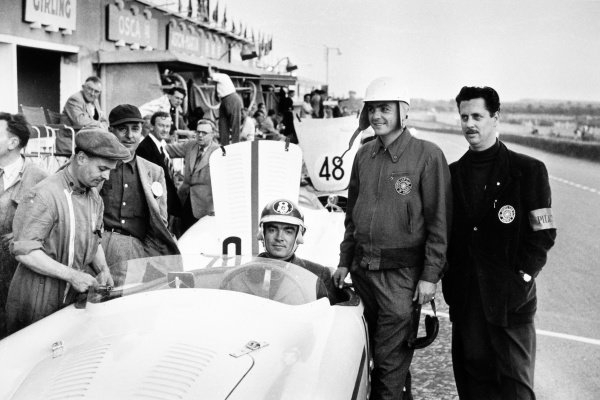 Le Mans, France. 13-14 June 1953. Fred Wacker jr (in car) and Phil Hill pose by the OSCA MT4 entered by Rees T. Makins. Makins was also reserve driver, portrait. World Copyright: LAT Photographic Ref: Autosport b&w print