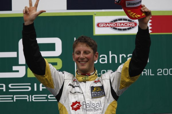 2008 GP2 Asia Series. Saturday Race.Bahrain International Circuit. Sakhir, Bahrain. 5th April. Romain Grosjean (FRA, ART Grand Prix) celebrates victory on the podium. World Copyright: Andrew Ferraro/GP2 Series Media Service. Service ref:__H0Y2651 jpg