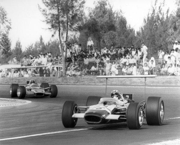 1968 Mexican Grand Prix.Mexico City, Mexico. 3 November 1968.Jo Siffert, Lotus 49B-Ford, 6th position, leads Graham Hill, Lotus 49B-Ford, 1st position, action.World Copyright: LAT PhotographicRef: Autosport b&w print