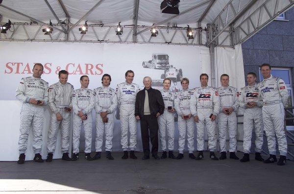2001 Stars and Cars WeekendStuttgart, Germany. 3rd - 4th Novenber 2001.Jurgen Huppert stand with the 2001 DTM drivers, portrait.World Copyright: Mercedes Benz Motorsport/LAT Photographicref: 18mb Digital Image Only.