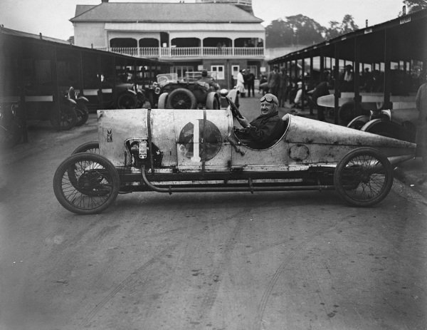 Archie Frazer Nash sits in his GN long wheelbase track car known as Mowgli, in the paddock.