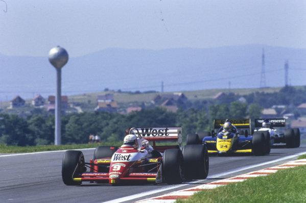 Martin Brundle, Zakspeed 871, leads Alessandro Nannini, Minardi M187 Motori Moderni, and Jonathan Palmer, Tyrrell DG016 Ford.