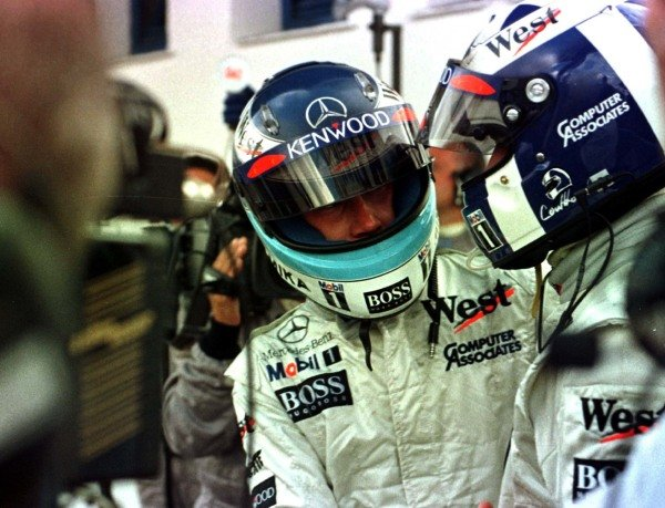 1997 European Grand Prix. Jerez, Spain. 24-26 October 1997. Mika Hakkinen and David Coulthard (both McLaren Mercedes-Benz) celebrate in parc ferme after finishing in 1st and 2nd positions. World Copyright - LAT Photographic