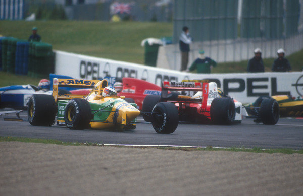 1992 French Grand Prix.Magny-Cours, France.3-5 June 1992.Ayrton Senna (McLaren MP4/7A Honda) is taken out by Michael Schumacher (Benetton B192 Ford) at the Adelaide Hairpin on the first lap.Ref-92 FRA 07.World Copyright - LAT Photographic