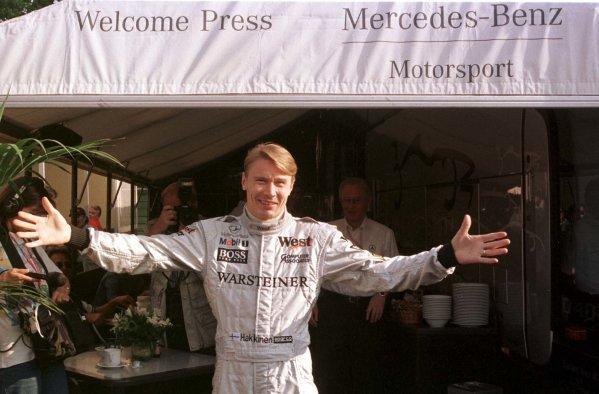 1998 San Marino Grand Prix.Imola, Italy.24-26 April 1998.Mika Hakkinen (McLaren Mercedes-Benz) after the presentation celebrating his 100th GP.World Copyright - Tee/LAT Photographic