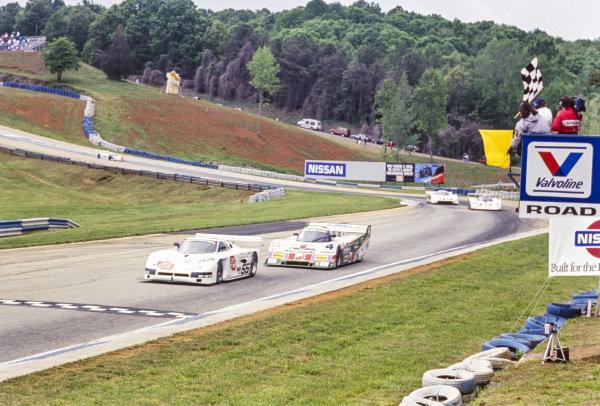 David Rocha / Mark Rodrigues, Huffaker Racing, Spice SE86L Buick, leads François Migault / Hugh Fuller, Tom Milner Racing, Intrepid RM-1 Chevrolet, as they cross the finish line.