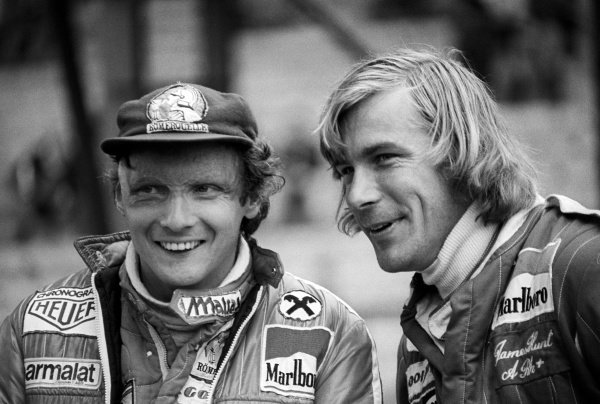 (L to R): Second placed Niki Lauda (AUT) Ferrari, talks with seventh placed James Hunt (GBR) McLaren. Belgian Grand Prix, Rd 7, Zolder, Belgium, 5 June 1977.