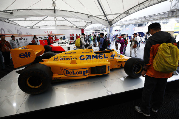 Fans admire a display of Honda-powered Lotus, McLaren and BAR F1 cars.