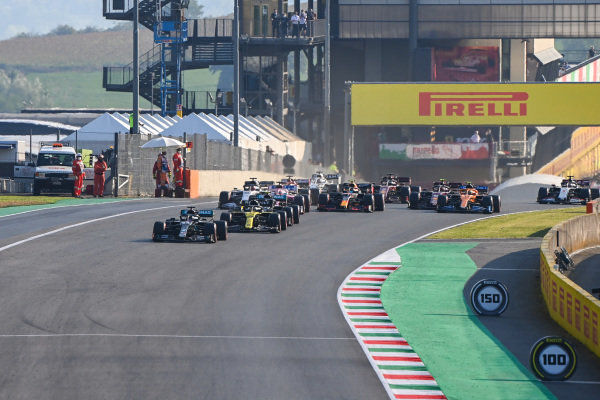 Lewis Hamilton, Mercedes F1 W11 EQ Performance, leads Daniel Ricciardo, Renault R.S.20, Valtteri Bottas, Mercedes F1 W11 EQ Performance, Alexander Albon, Red Bull Racing RB16, Sergio Perez, Racing Point RP20, and the rest of the field for the second restart