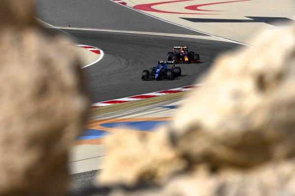 Esteban Ocon, Alpine A521, leads Max Verstappen, Red Bull Racing RB16B