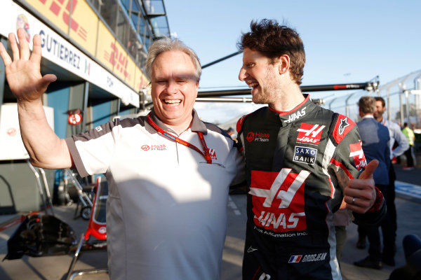 Albert Park, Melbourne, Australia. Sunday 20 March 2016. Gene Haas, Team Owner, Haas F1, and Romain Grosjean, Haas F1. World Copyright: Sam Bloxham/LAT Photographic ref: Digital Image _R6T4486