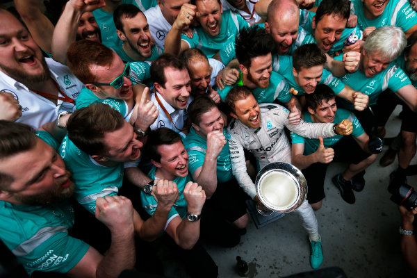 Shanghai International Circuit, Shanghai, China. Sunday 17 April 2016. Nico Rosberg, Mercedes AMG, 1st Position, and the Mercedes team celebrate with the winners trophy. World Copyright: Sam Bloxham/LAT Photographic ref: Digital Image _R6T1904