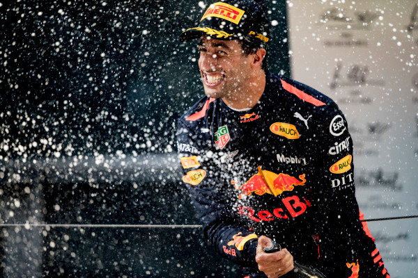 Daniel Ricciardo, Red Bull Racing, 1st position, sprays Champagne on the podium.