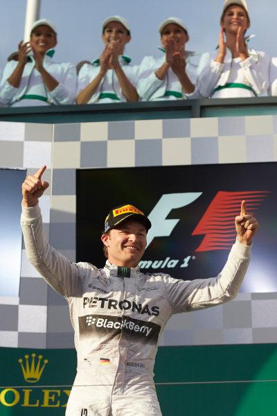 Albert Park, Melbourne, Australia. Sunday 16 March 2014. Nico Rosberg, Mercedes AMG, 1st Position, arrives on the podium. World Copyright: Steve Etherington/LAT Photographic. ref: Digital Image SNE26163 copy