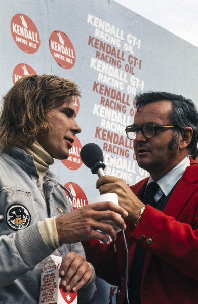 James Hunt, 2nd position, is interviewed on the podium.
