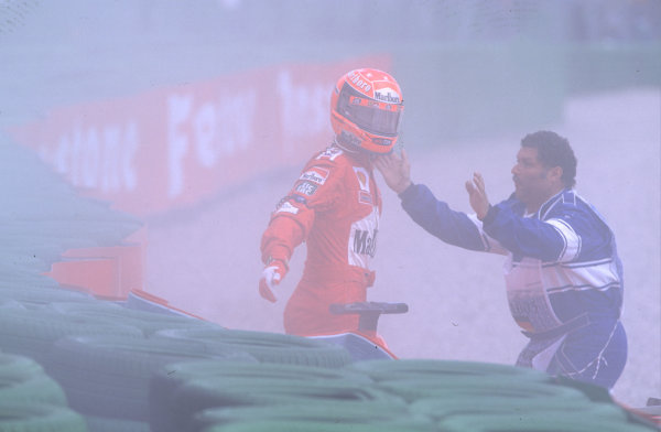 2000 German Grand Prix.Hockenheim, Germany.28-30 July 2000.Michael Schumacher (Ferrari) steps out of his car after he had pulled across into Giancarlo Fisichella (Benetton B200 Playlife) on the approach to the Nordkurve at the start, resulting in a crash.World Copyright - Coates/LAT Photographiccrash sequence 10.ref: 35mm A13