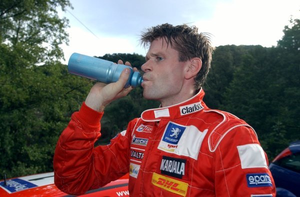 Marcus Gronholm (FIN), Peugeot, takes some refreshment!.