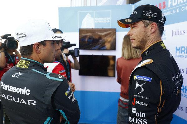 Mitch Evans (NZL), Panasonic Jaguar Racing, and Andre Lotterer (DEU), DS TECHEETAH, talk during qualifying