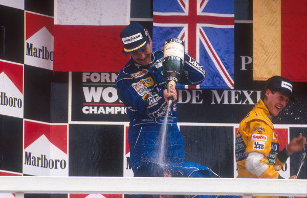 1992 Mexican Grand Prix.Mexico City, Mexico.20-22 March 1992.Nigel Mansell, 1st position gives Riccardo Patrese 2nd position (both Williams Renault) a showering of champagne on the podium. Behind is Michael Schumacher (Benetton Ford) 3rd position. Ref-92 MEX 06.World Copyright - LAT Photographic