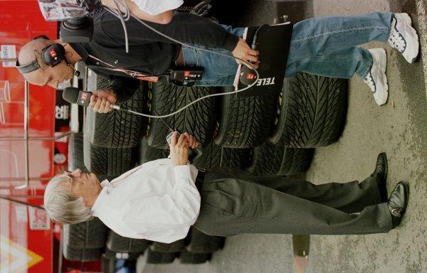 1998 Hungarian Grand Prix.Hungaroring, Budapest, Hungary.14-16 August 1998.Bernie Ecclestone is interviewed in the paddock.World Copyright - Steve Etherington/LAT Photographic