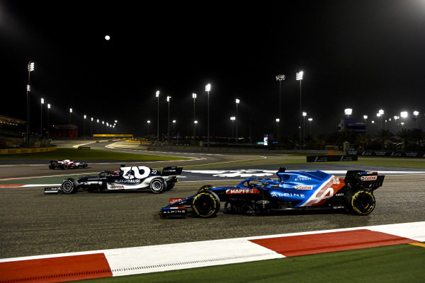 Yuki Tsunoda, AlphaTauri AT02, leads Fernando Alonso, Alpine A521