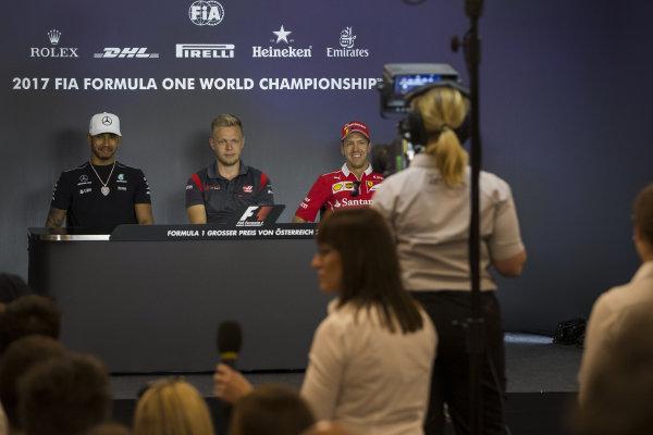 Lewis Hamilton (GBR) Mercedes AMG F1, Kevin Magnussen (DEN) Haas F1 and Sebastian Vettel (GER) Ferrari in the Press Conference at Formula One World Championship, Rd9, Austrian Grand Prix, Preparations, Spielberg, Austria, Thursday 6 July 2017.